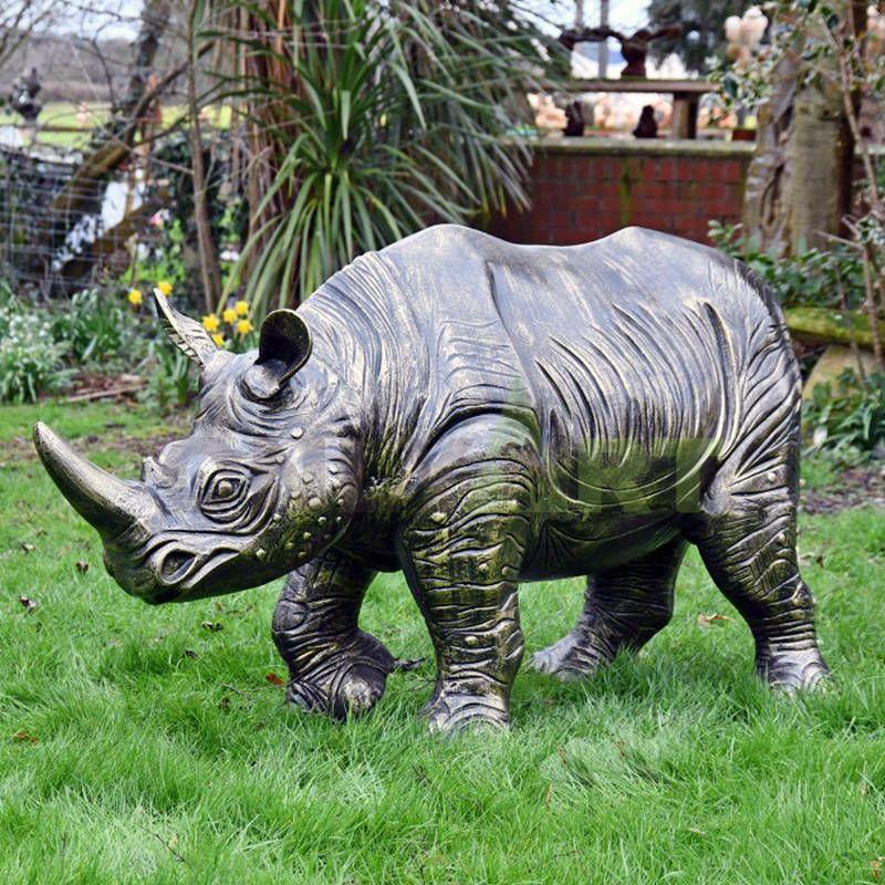 Rhinoceros bronze sculpture breaks through the fence