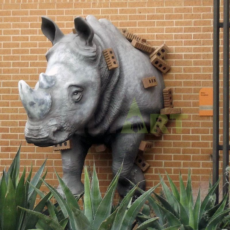 A large bronze statue of an African rhino