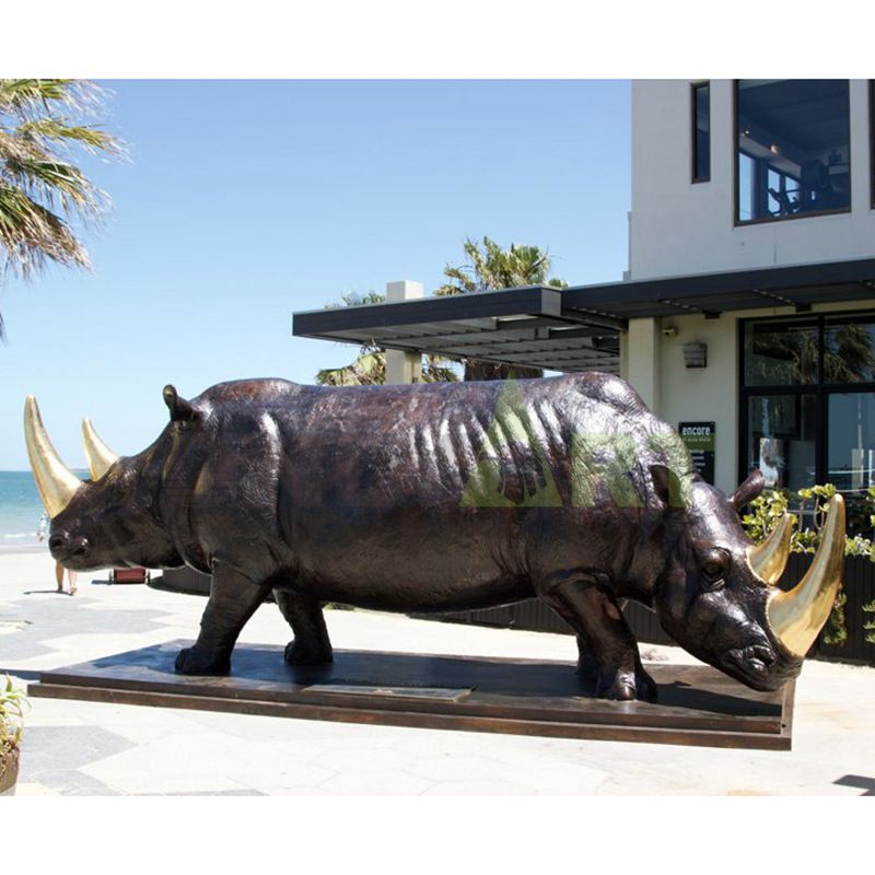 Two-sided conjoined rhinoceros sculpture