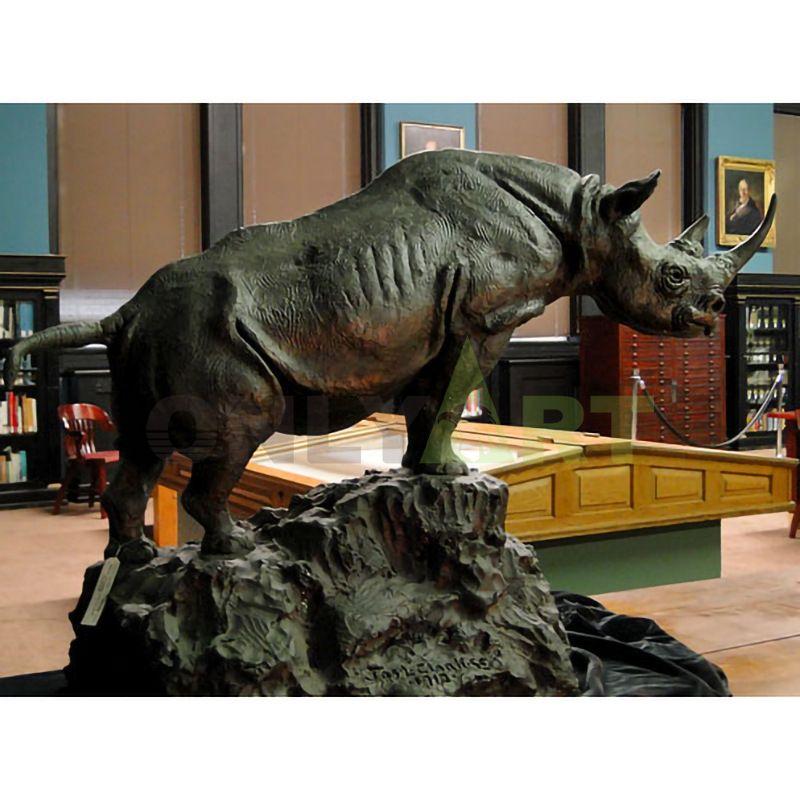 Bronze rhinoceros standing on a stone