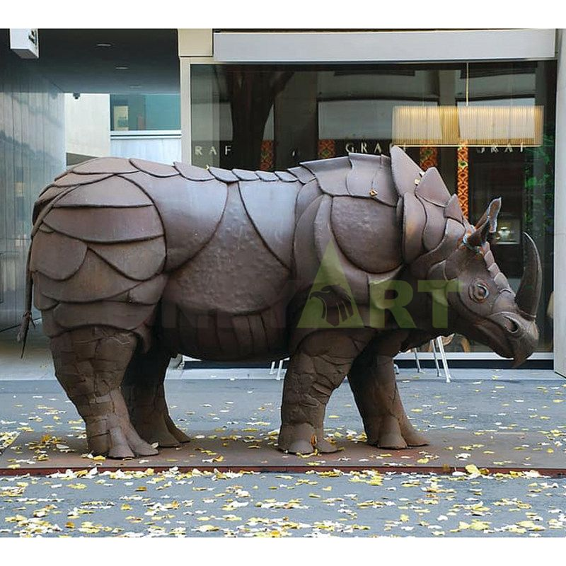 Large stainless steel rhino sculpture outdoor metal brushed geometric animal landscape