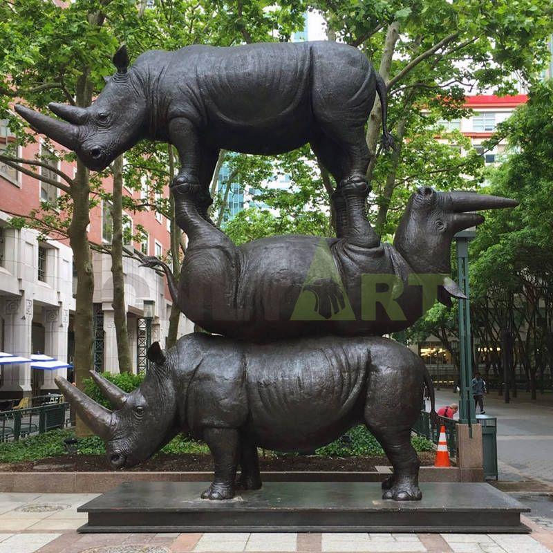 A rhinoceros version of a human pyramid