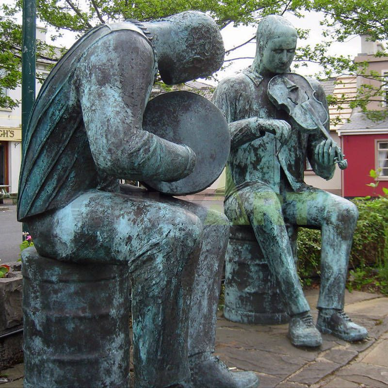 Outdoor couples explore musical sculpture
