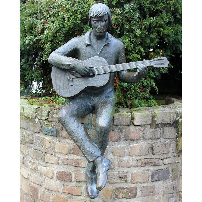 Bronze sculpture of singer with short hair