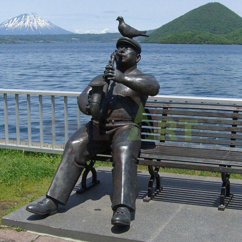 bronze sculpture of musician statue