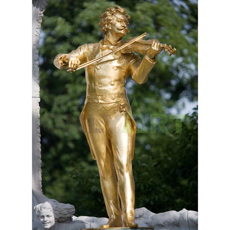 Sculpture of a golden violinist