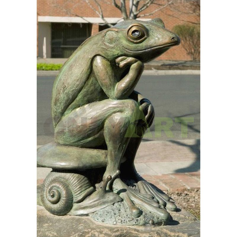 the bronze statue of Mr. Frog who is intoxicated with music