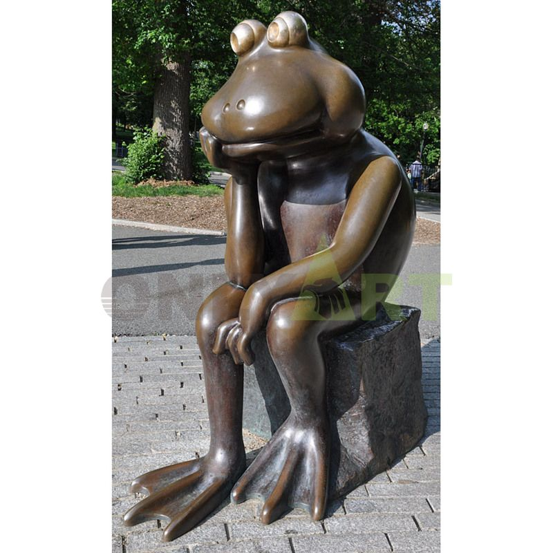 A frog sitting on a stone pier thinking about life