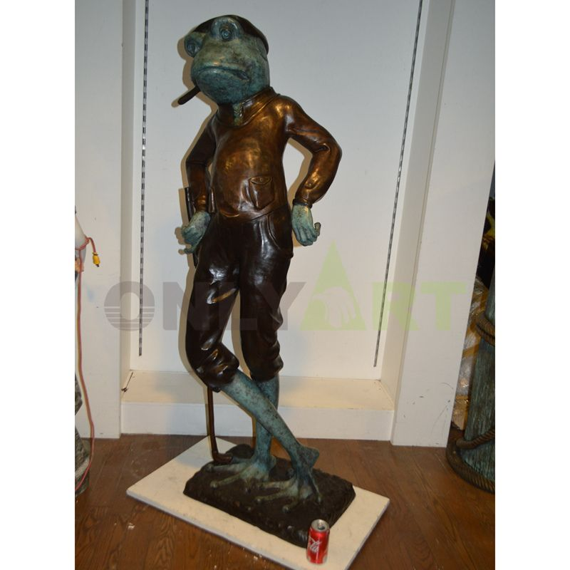 Bronze Statue of Mr. Frog standing inside